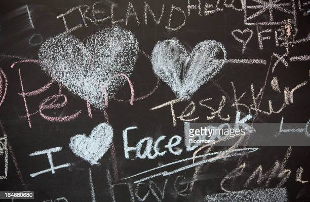 A blackboard is decorated with heart symbols and a message that reads 'I Love Facebook' as it sits inside the offices at Facebook Inc's European...