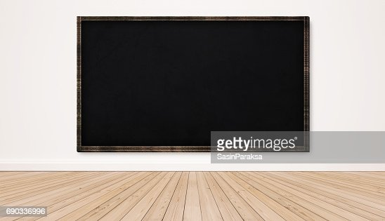 Blackboard on white wall with wood floor, empty classroom : Stock Photo