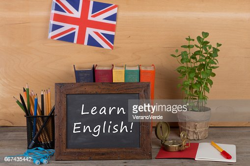 blackboard with text 'Learn English!', flag of the United Kingdom : Stock Photo