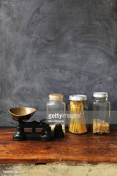 Blackboard with wooden table and glass jars