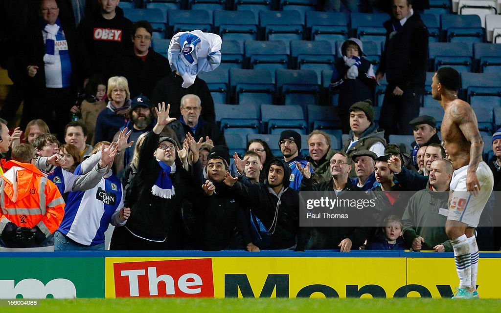 Blackburn fans scramble to catch the shirt thrown into the crowd by <a gi-track='captionPersonalityLinkClicked' href=/galleries/search?phrase=Colin+Kazim-Richards&family=editorial&specificpeople=684189 ng-click='$event.stopPropagation()'>Colin Kazim-Richards</a> (R) of Blackburn after the FA Cup with Budweiser Third Round match between Blackburn Rovers and Bristol City at Ewood Park on January 5, 2013 in Blackburn, England.