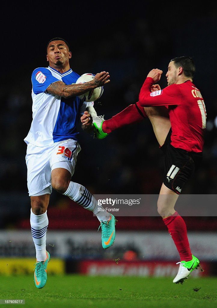 Blackburn player <a gi-track='captionPersonalityLinkClicked' href=/galleries/search?phrase=Colin+Kazim-Richards&family=editorial&specificpeople=684189 ng-click='$event.stopPropagation()'>Colin Kazim-Richards</a> (l) challenges Craig Conway during the npower Championship match between Blackburn Rovers and Cardiff City at Ewood park on December 7, 2012 in Blackburn, England.