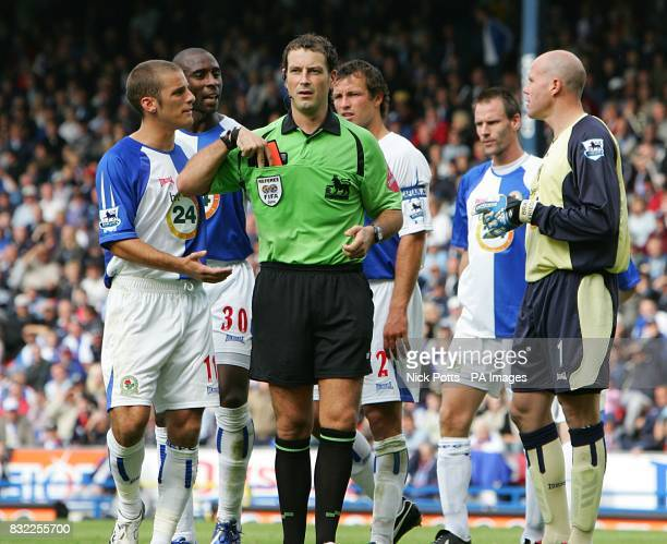 Blackburn players complain to referee Mark Clattenburg after he awards Chelsea a penalty