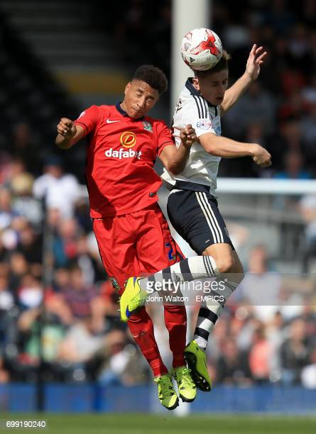 Blackburn Rovers' Adam Henley and Fulham's Tom Cairney battle for the ball in the air