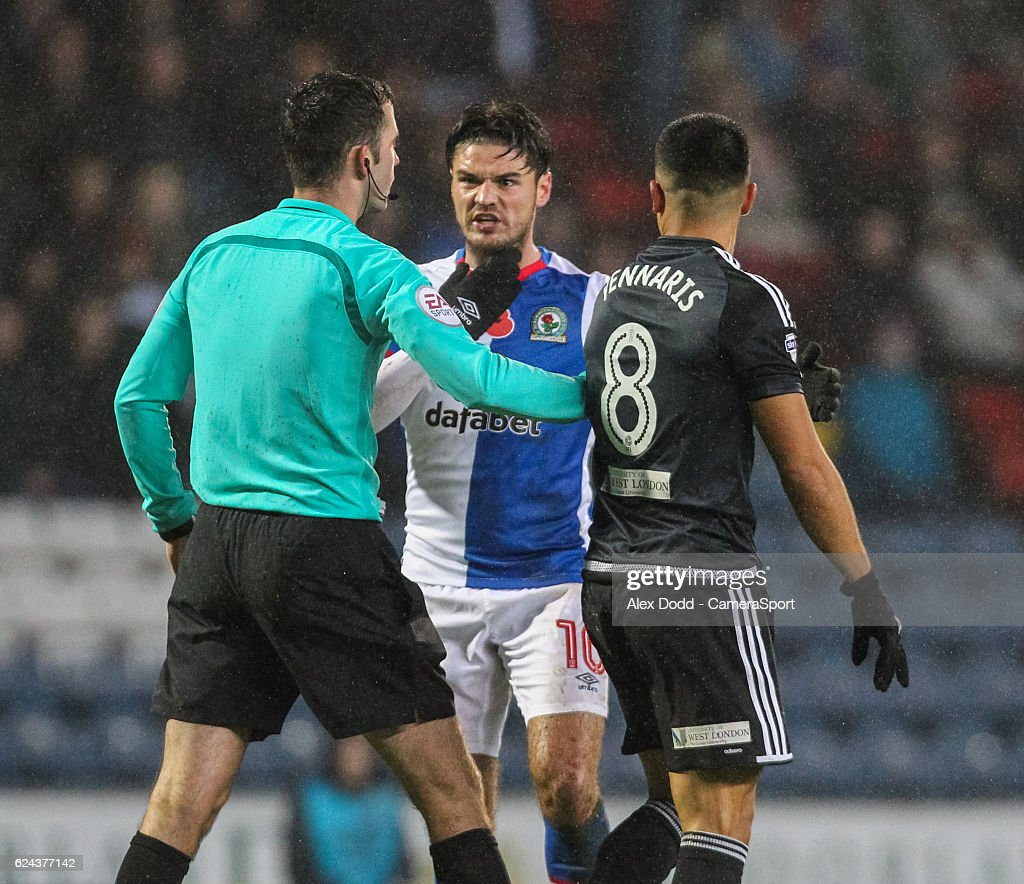 Blackburn Rovers' Ben Marshall remonstrates with referee Chris Kavanagh after some aggressive treatment from Brentford's Nico Yennaris during the Sky Bet Championship match between Blackburn Rovers and Brentford at Ewood Park on November 19, 2016 in Blackburn, England.
