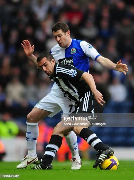 Blackburn Rovers' Brett Emerton and Newcastle United's Sanchez Jose Enrique in action