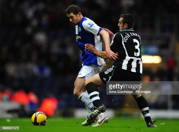 Blackburn Rovers' Brett Emerton and Newcastle United's Sanchez Jose Enrique battle for the ball