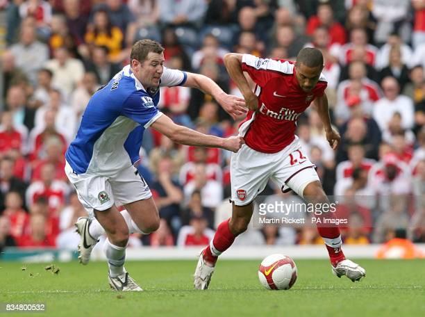 Blackburn Rovers' Brett Emerton holds onto Arsenal's Gael Clichy as they battle for the ball