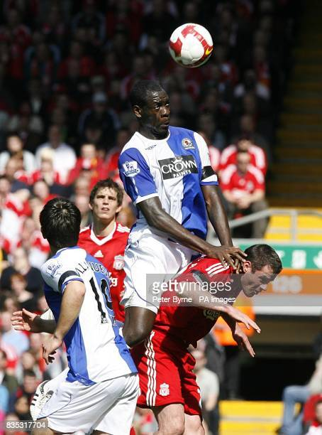 Blackburn Rovers' Christopher Samba and Liverpool's Jamie Carragher battle for the ball