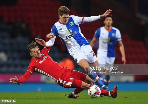 Blackburn Rovers' Connor Mahoney is tackled by Cardiff City's Joe Bennett during the Sky Bet Championship match between Blackburn Rovers and Cardiff...