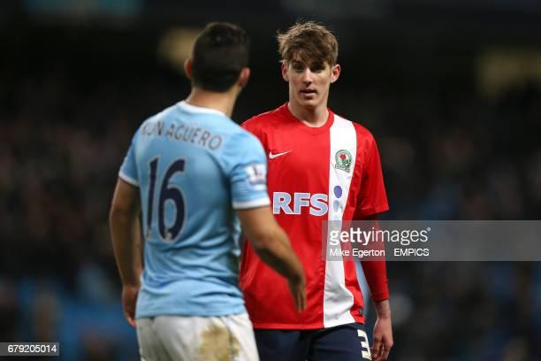 Blackburn Rovers' Connor Mahoney talks to Manchester City's Sergio Aguero
