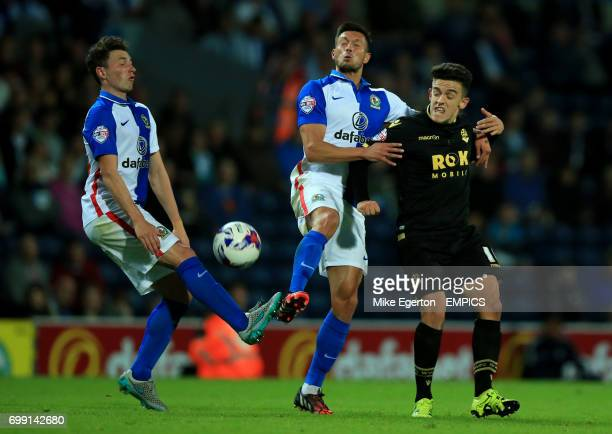 Blackburn Rovers' Corry Evans and Jason Lowe battle for the ball with Bolton Wanderers' Zach Clough