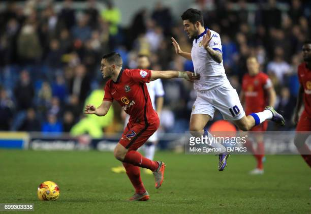 Blackburn Rovers' Craig Conway and Leeds United's Alex Mowatt in action