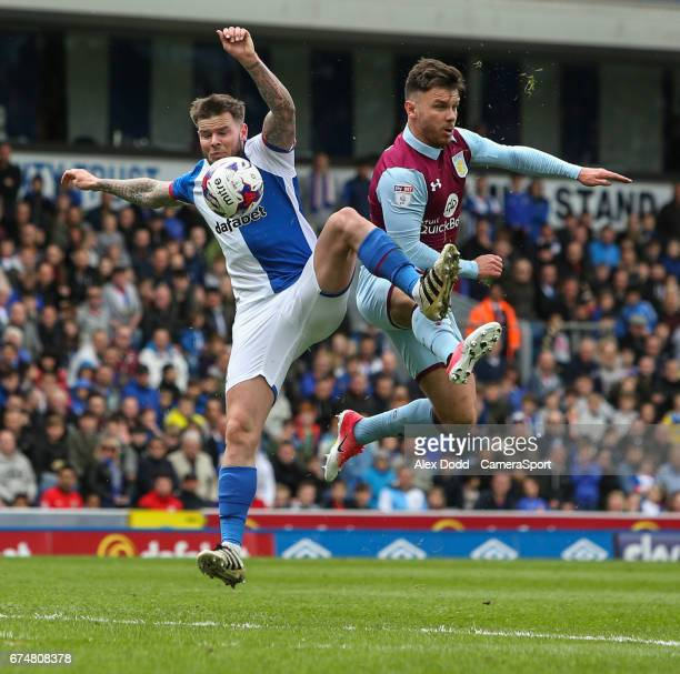 Blackburn Rovers' Danny Guthrie battles with Aston Villa's Scott Hogan during the Sky Bet Championship match between Blackburn Rovers and Aston Villa...