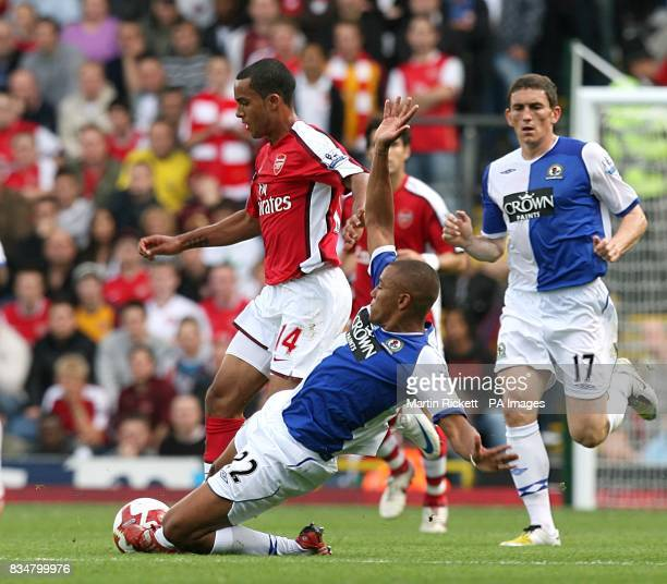 Blackburn Rovers' Danny Simpson challenges Arsenal's Theo Walcott for the ball