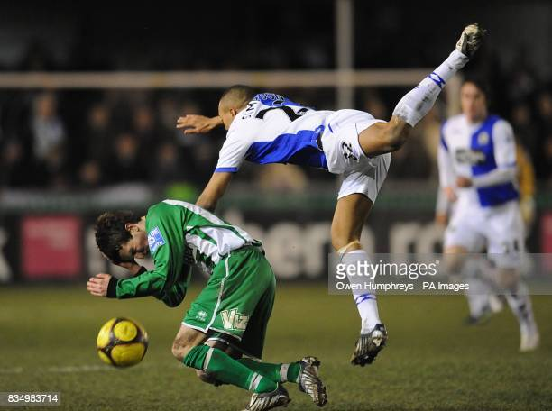 Blackburn Rovers' Danny Simpson flies over Blyth Spartans' Ged Dalton in a battle for the ball