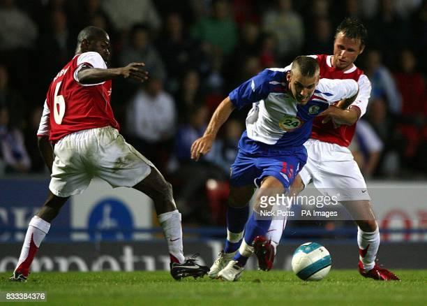 Blackburn Rovers' David Bentley battles for the ball with MyPa's Kuami Agboh and Nebi Mustafi