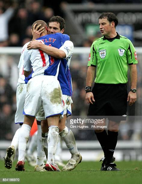 Blackburn Rovers' David Bentley celebrates scoring his sides third goal of the match with teammate David Dunn as controversial referee Mark...