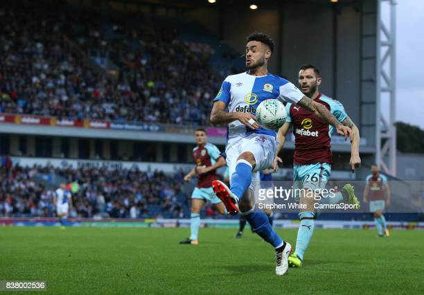 Blackburn Rovers' Derrick Williams and Burnley's Phillip Bardsley during the Carabao Cup Second Round match between Blackburn Rovers and Burnley at...