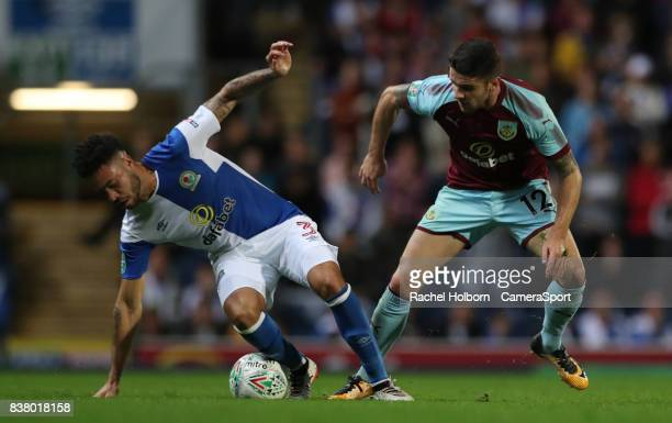 Blackburn Rovers' Derrick Williams and Burnley's Robbie Brady during the Carabao Cup Second Round match between Blackburn Rovers and Burnley at Ewood...