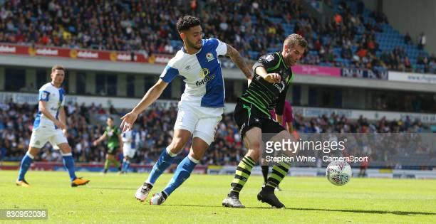 Blackburn Rovers' Derrick Williams and Doncaster Rovers' Matty Blair during the Sky Bet League One match between Blackburn Rovers and Doncaster...