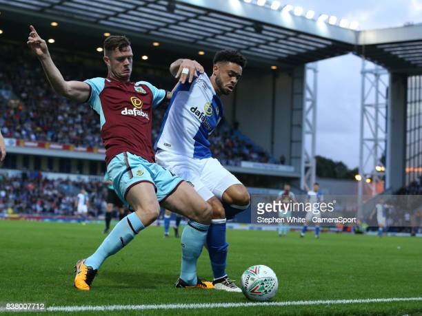 Blackburn Rovers' Derrick Williams battles with Burnley's Kevin Long during the Carabao Cup Second Round match between Blackburn Rovers and Burnley...