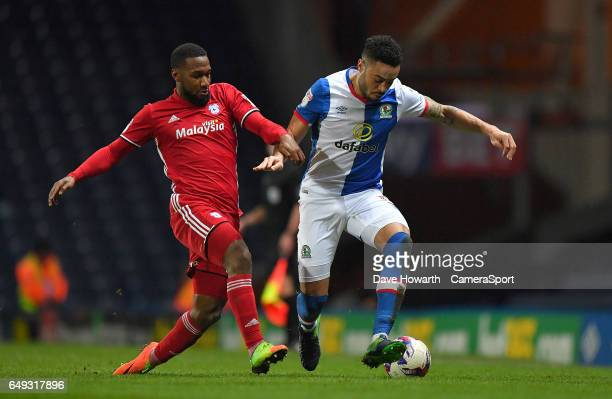 Blackburn Rovers' Derrick Williams battles with Cardiff City's Junior Hoilett during the Sky Bet Championship match between Blackburn Rovers and...