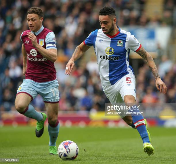 Blackburn Rovers' Derrick Williams gets away from Aston Villa's James Chester during the Sky Bet Championship match between Blackburn Rovers and...