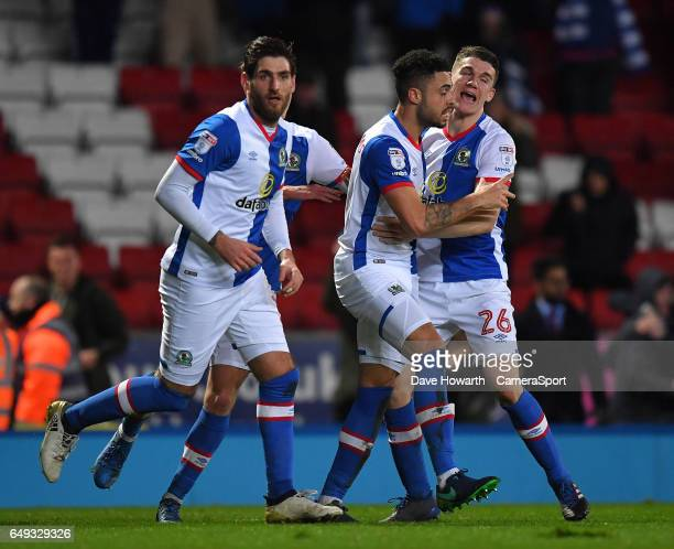 Blackburn Rovers' Derrick Williams is congratulated on scoring his team's equalising goal during the Sky Bet Championship match between Blackburn...