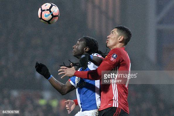 Blackburn Rovers' Dutch striker Marvin Emnes vies with Manchester United's English defender Chris Smalling during the English FA Cup fifth round...