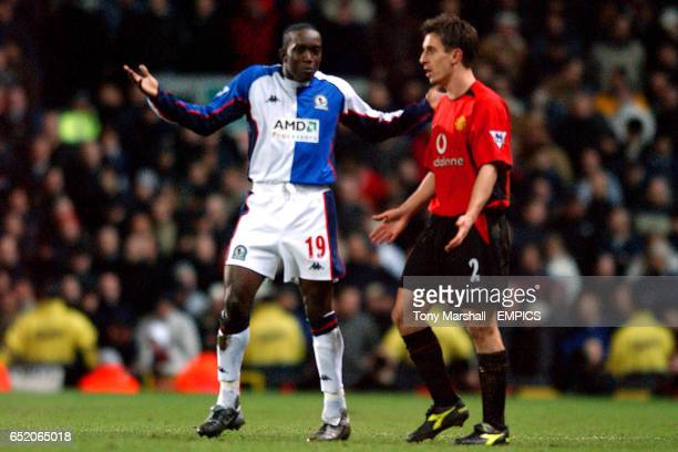 Blackburn Rovers' Dwight Yorke and Manchester United's Gary Neville shrug their shoulders at the refree's decision