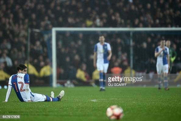 Blackburn Rovers' English striker Danny Graham reacts after Manchester United score their second goal during the English FA Cup fifth round football...