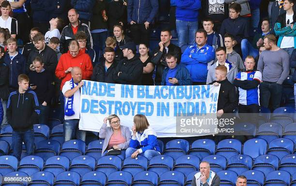 Blackburn Rovers fans hold up a banner in the stands