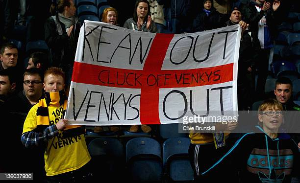 Blackburn Rovers fans protest against their manager Steve Kean and club owners the Venkys during the Barclays Premier League match between Blackburn...