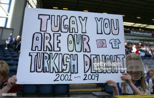 Blackburn Rovers fans unveil a banner in the stands reading Tugay you are our Turkish Delight 2001 2009
