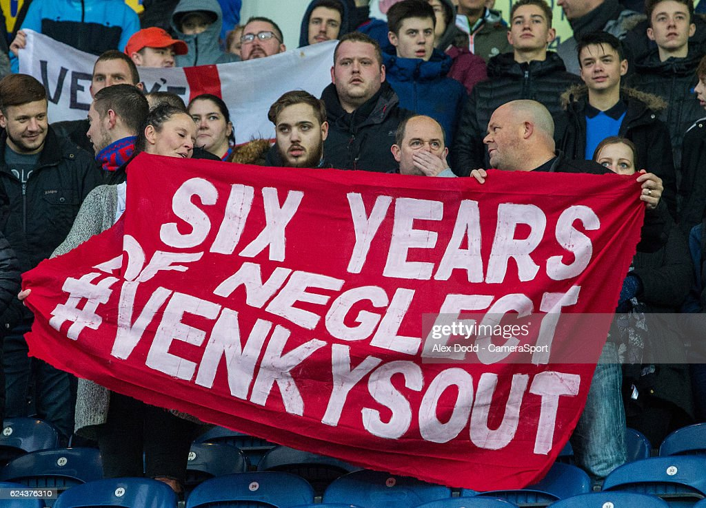 Blackburn Rovers fans voice their anger at the owners during the first half during the Sky Bet Championship match between Blackburn Rovers and Brentford at Ewood Park on November 19, 2016 in Blackburn, England.
