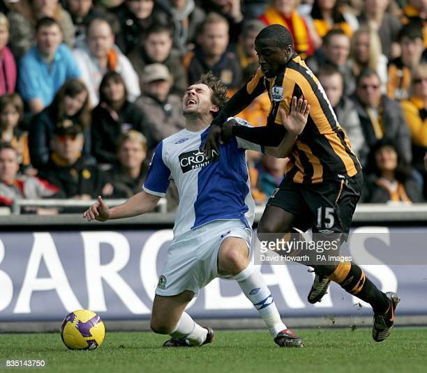 Blackburn Rovers' Gael Givet is fouled by Hull City's Bernard Mendy as they battle for the ball