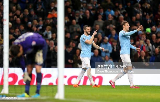 Blackburn Rovers goalkeeper Paul Robinson dejected as Manchester City's Alvaro Negredo celebrates scoring his side's second goal of the game