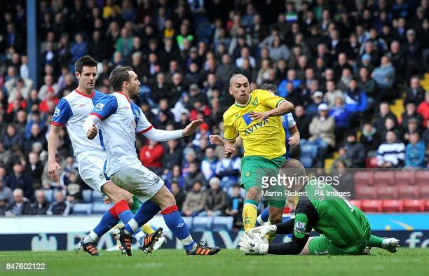 Blackburn Rovers goalkeeper Paul Robinson saves at the feet of Norwich City's James Vaughan