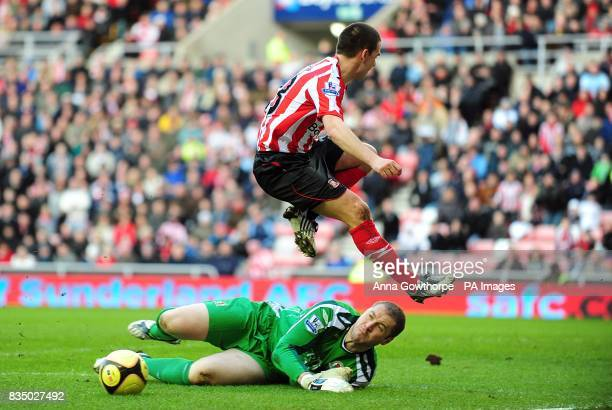Blackburn Rovers' goalkeeper Paul Robinson tries to make a save as he almost collides with Sunderland's David Healy