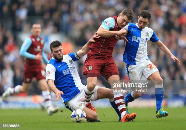 Blackburn Rovers' Grant Hanley and Corry Evans and Burnley's Sam Vokes