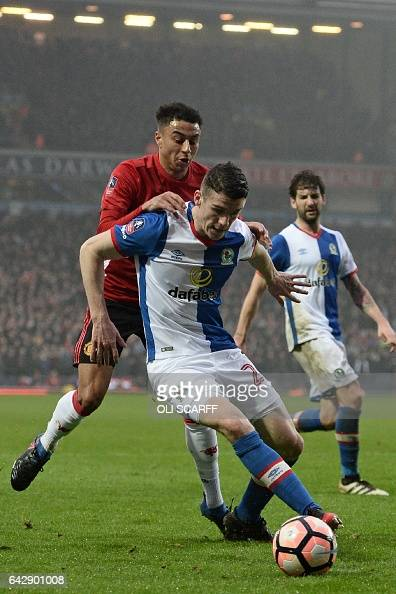 Blackburn Rovers' Irish midfielder Darragh Lenihan holds off Manchester United's English midfielder Jesse Lingard during the English FA Cup fifth...