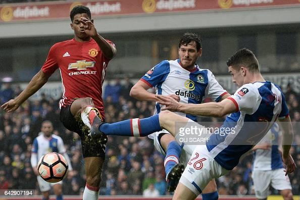 Blackburn Rovers' Irish midfielder Darragh Lenihan vies with Manchester United's English striker Marcus Rashford during the English FA Cup fifth...