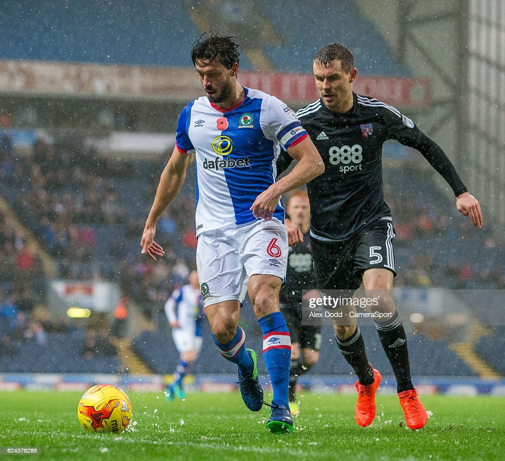 Blackburn Rovers' Jason Lowe shields the ball from Brentford's Andreas Bjelland during the Sky Bet Championship match between Blackburn Rovers and Brentford at Ewood Park on November 19, 2016 in Blackburn, England.