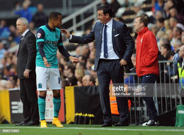 Blackburn Rovers manager Gary Bowyer talks with Marcus Olsson