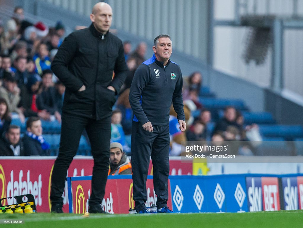Blackburn Rovers manager Owen Coyle joins Reading manager Jaap Stam in shouting instructions to his team from the dug-out during the Sky Bet Championship match between Blackburn Rovers and Reading at Ewood Park on December 17, 2016 in Blackburn, England.