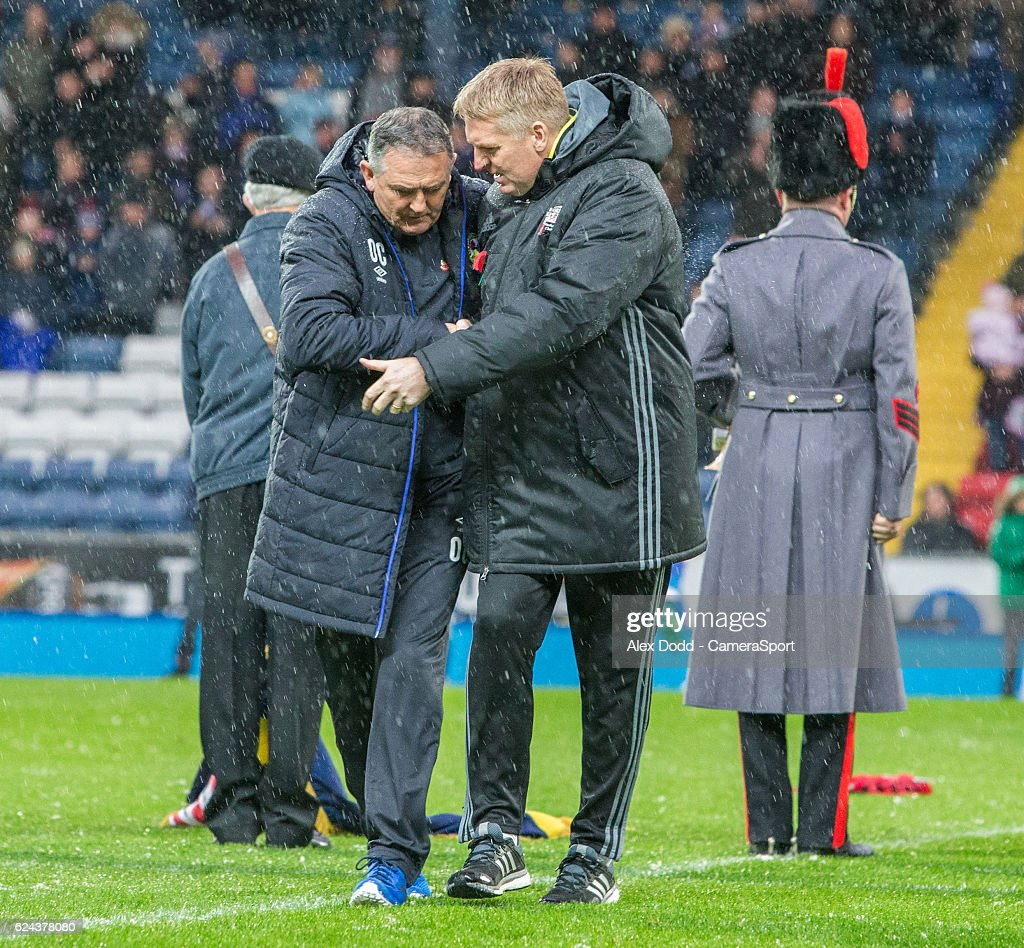 Blackburn Rovers manager Owen Coyle shares a word with Brentford manager Dean Smith after observing a minute silence during the Sky Bet Championship match between Blackburn Rovers and Brentford at Ewood Park on November 19, 2016 in Blackburn, England.