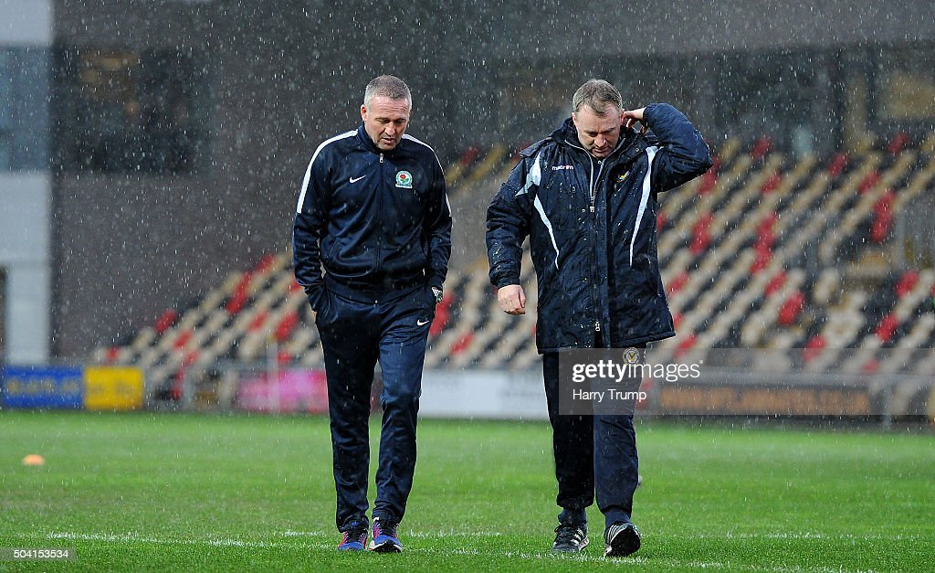 Blackburn Rovers Manager Paul Lambert and John Sheridan Manager of Newport County chat as heavy rain forces the postponement of the match during The...