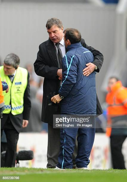 Blackburn Rovers manager Sam Allardyce and West Ham United manager Gianfranco Zola shake hands after the final whistle