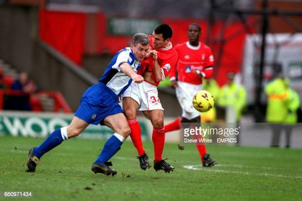 Blackburn Rovers' Mark Hughes and Nottingham Forest's Francis Benali battle for the ball